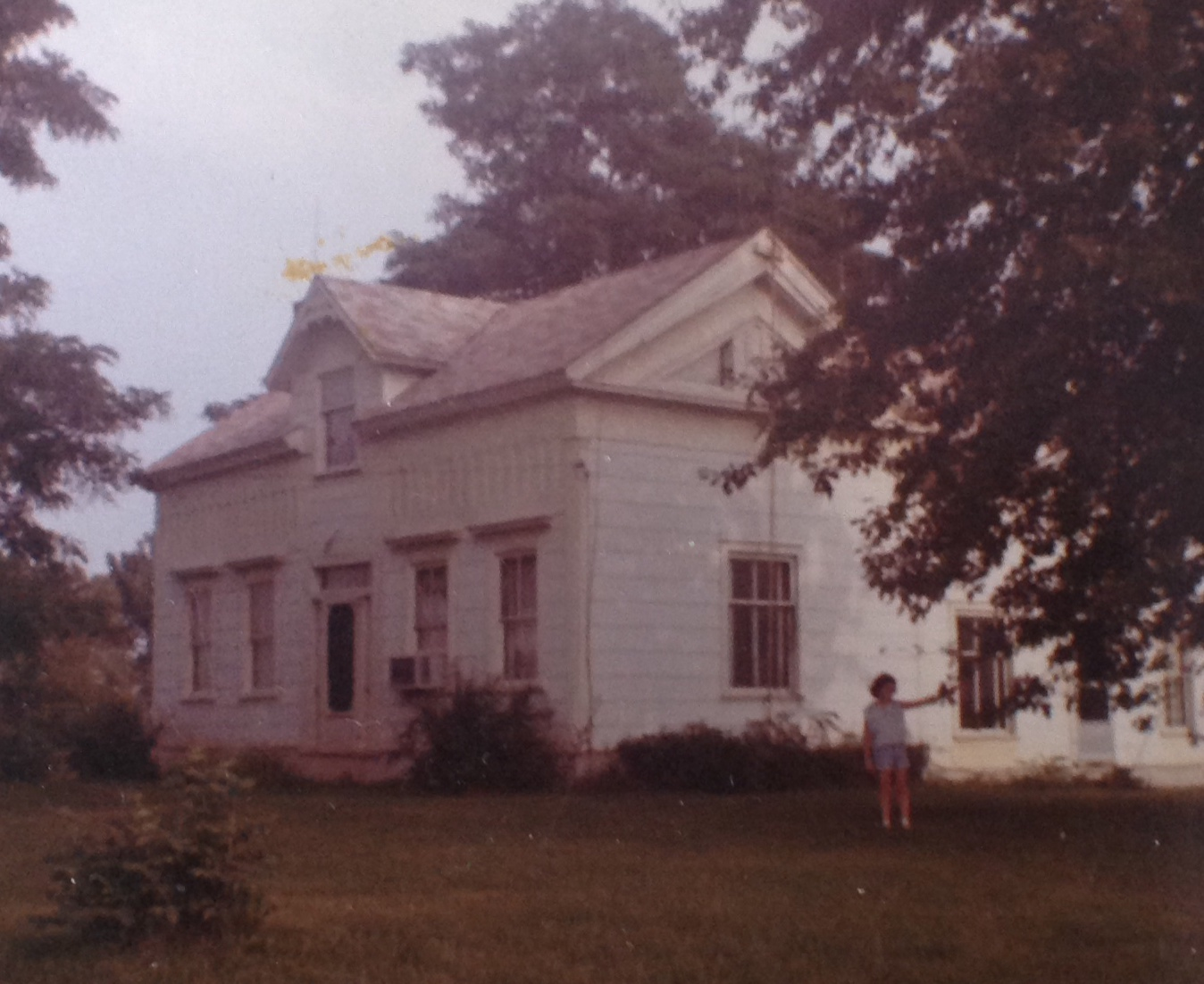 Photo of the front of our 100 year old farm house taken in the year of 1960.
